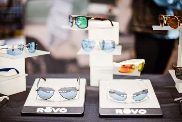 revo sunglasses on table