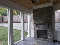 Screen Porch Built in Fireplace