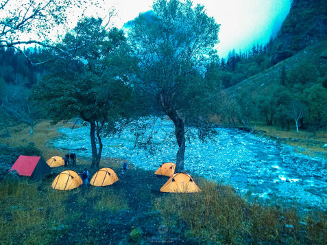Camp site beside a river
