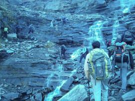 Crossing waterfalls on slipper rocks