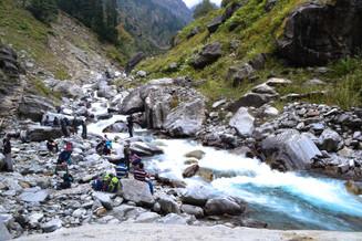 Team taking break at the stream on trail