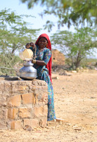 Local woman fetching water from nearby well
