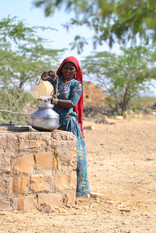 Local woman, fetching water from near by well