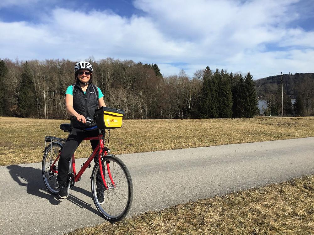 Claudia cycling alongside...