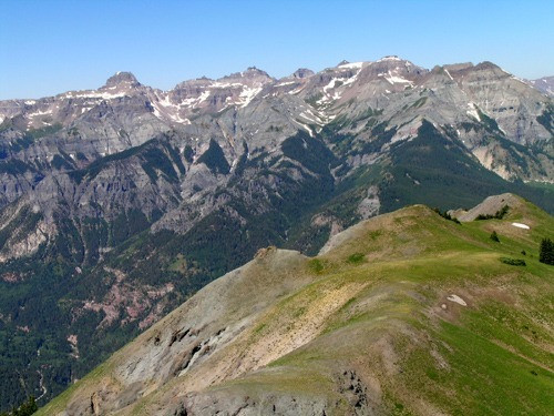 snow capped mountains against a blue sky in ouray colorado best summer hikes in ouray