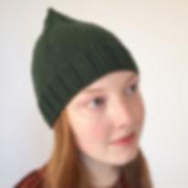 green treetop hat on woman