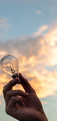 Canva - Person Holding Clear Light Bulb.