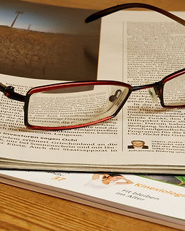 Glasses on a newspaper