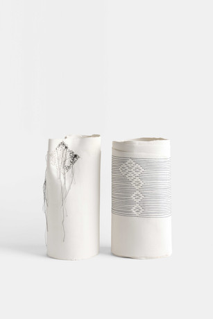 Porcelain with embroidery.