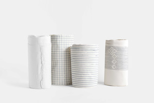 Porcelain with manual prin and embroidery.
