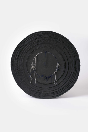 Black porcelain with embroidery.
