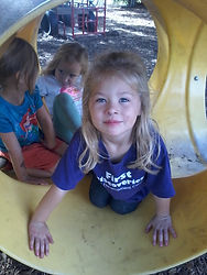 girl in a tunnel on playground.jpg