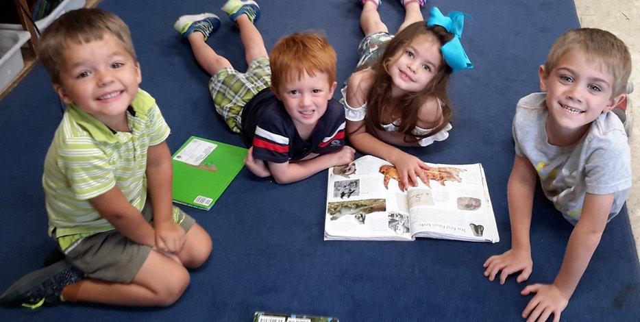Children reading together in prekinderga