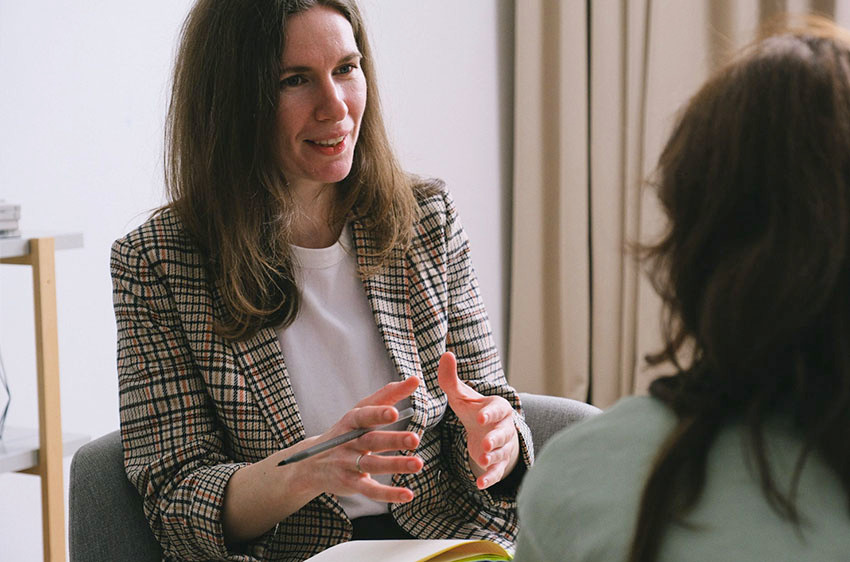 female psychologist talking to patient