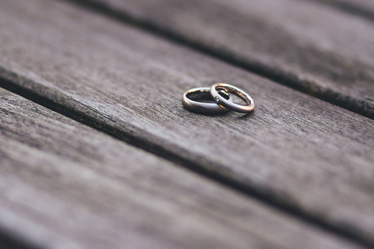 Wedding rings on wood - marriage counselling