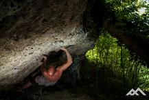 A man doing some impressive bouldering moves