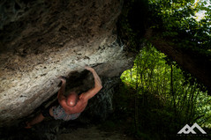 A man doing some impressive bouldering moves