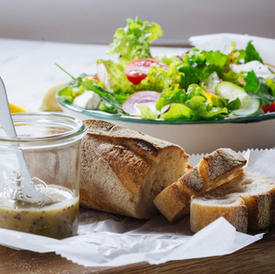 Salad, sourdough bread with delicate and mustard
