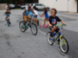 Global Children riding bikes in the GO Church parking lot