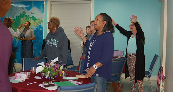 Women worship at a Global Outreach Church event