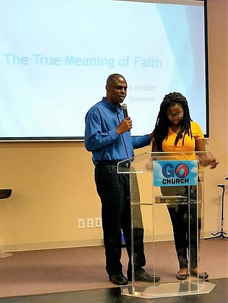 "Pastor Chris Cunningham prays for 12 year old Gianina, before she presents the message in a Sunday Celebration Service. ""The True Meaning of Faith. She did a fantastic job."