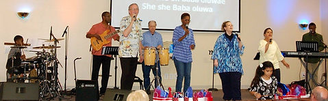 The GO Church Worship Team leads in a song