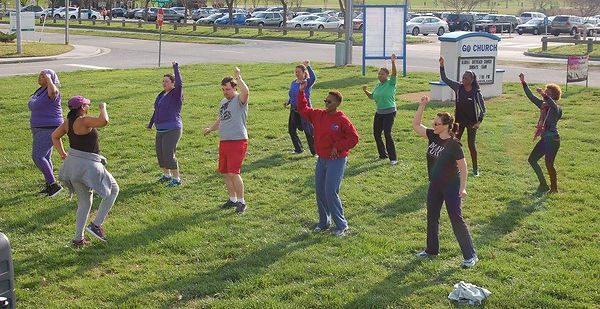 Exercisers with hands in the air