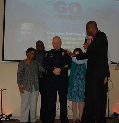 Praying for Captain Pat Gallagher at Global Outreach Church.