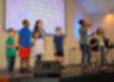 Global Children leading worship in a Sunday Celebration Service