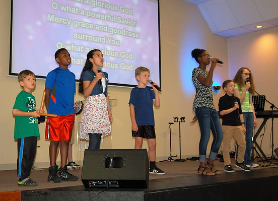 Global Children leading worship in a Sunday Celebration Service