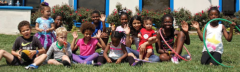 Some of our Global Children posing outside the church