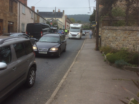 10.15am Chideock hillgoing west another lorry tanker struggling up the hill casusing huge tail back