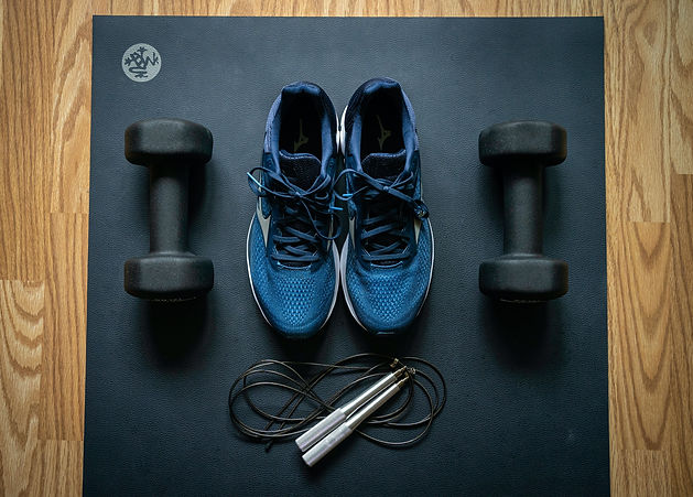 Blue workout shoes and weights