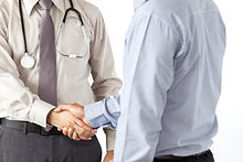 Doctor and man shacking hand on solid white background.jpg