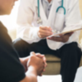 Doctor consulting male patient, working on diagnostic examination on men's health disease or mental