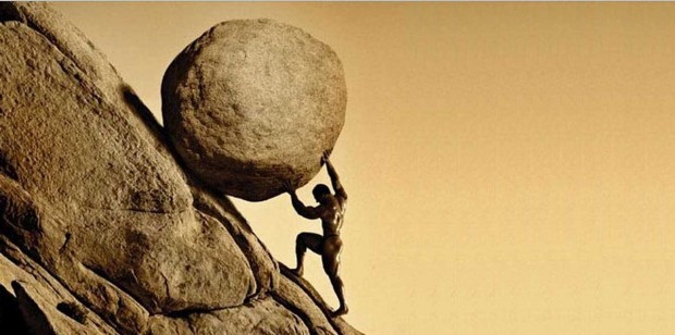 Sisyphus pushing a boulder up a hill