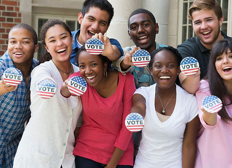 students-holding-buttons-at-voter-regist