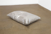 Laid, 2017, silver leaf on two feather pillows, dimensions variable.