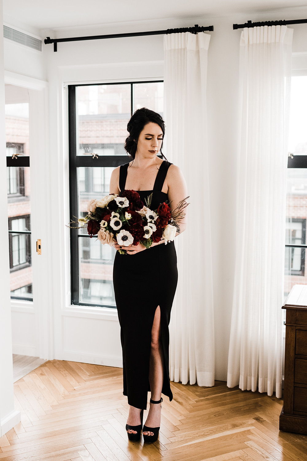Bride holding her wedding bouquet for portraits