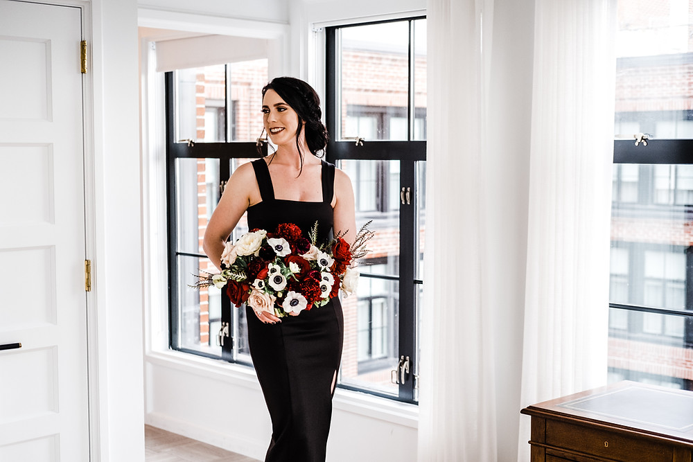 Bride holding her bouquet during a portrait session in her hotel suite