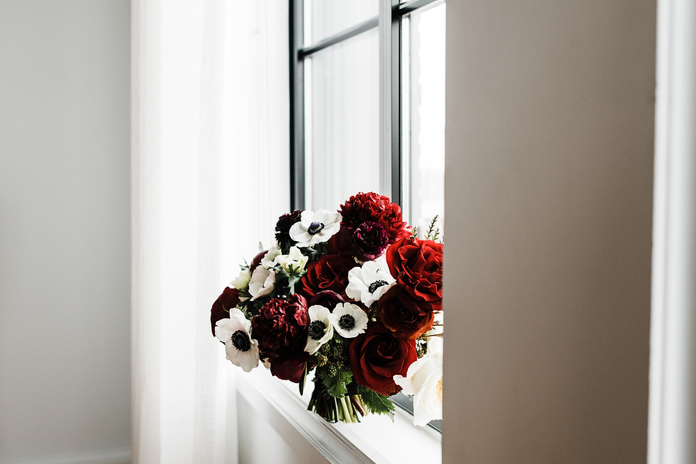 Bridal bouquet photographed on a window sill
