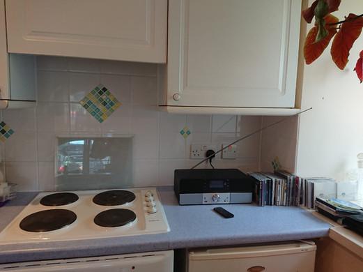 Oven, hob, fridge and media centre