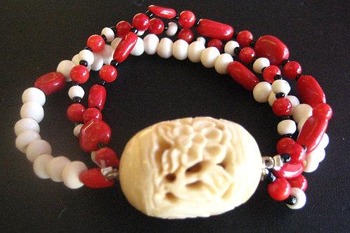 Carved bone & Red Coral stretch bracelet
