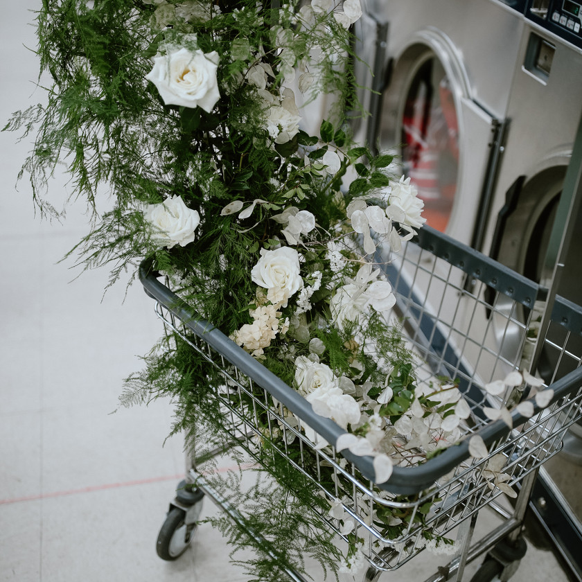 Close up detail shot of wedding flowers on the laundry cart