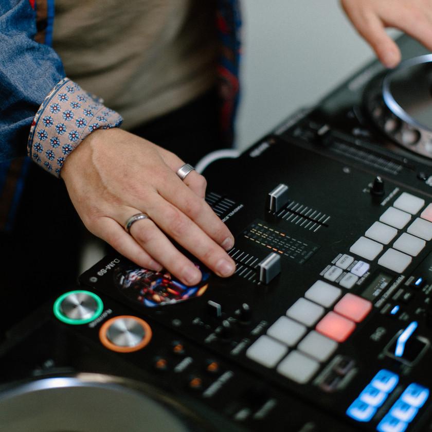 Close up detail shot of DJ hands using equipment
