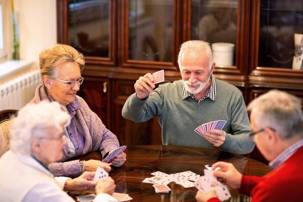 A group of elders playing cards together.