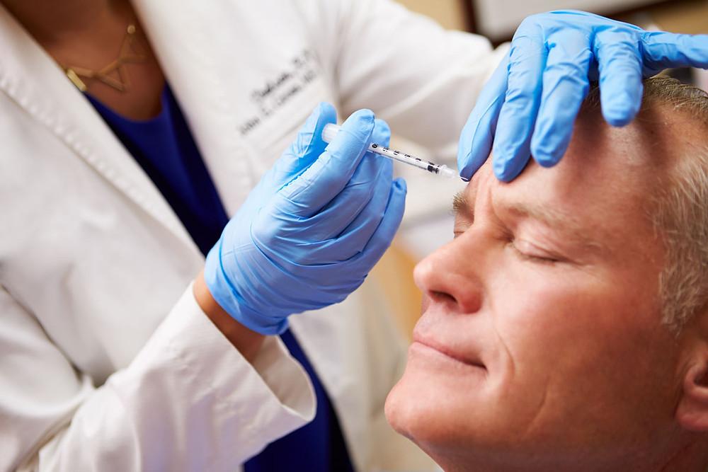 Elder-gentleman-getting-botox-injections-to-lessen-the-signs-of-aging