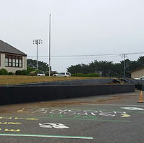Freshly painted front garden beds at Gold Beach High School