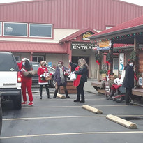 GBMS Volunteers helping Santa at the Drive-through