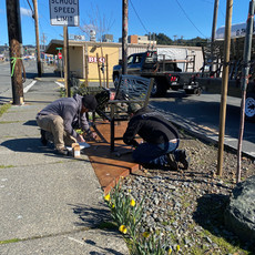 The Ferguson Fabrication team installing benches at Woof's/Smoke Hut site!